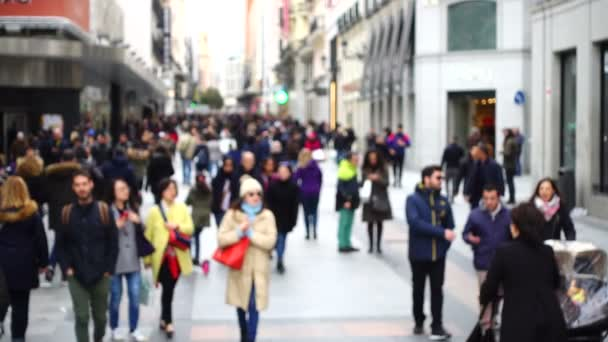 Tourists on streets of Madrid. Out of focus. Slow motion. Shooting in Spain.
