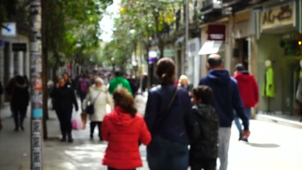 People on streets of Madrid. Out of focus. Slow motion. Movement of people along Fuencarral street.