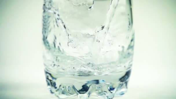 Water is poured in a glass. Slow motion. 240 fps. Slow motion.