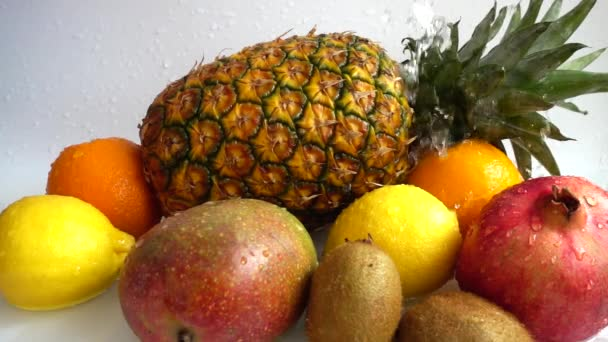 Juicy ripe tropical fruits. Slow motion.