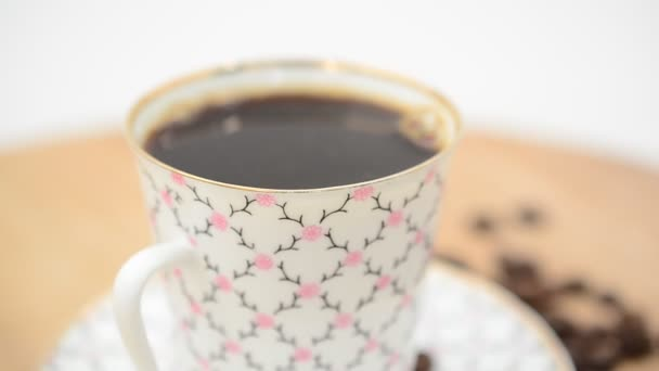 Closeup of Coffee, coffee cup and grains. Shooting in the movement.