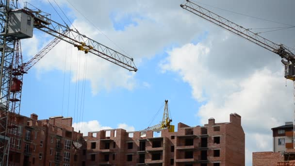 Construction cranes over houses. Construction of residential buildings.