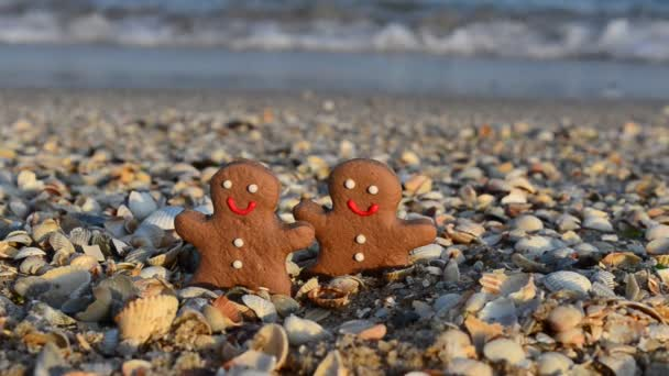 Gingerbread little men on the beach. Shooting in the summer.