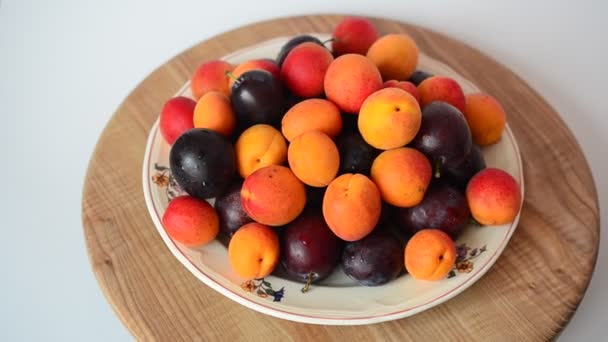 Apricots and plums, fruit. Shooting of fruit.