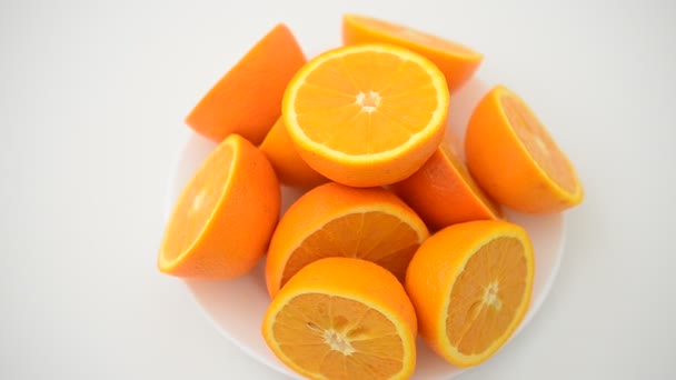 Oranges on a white background. Shooting in the movement.