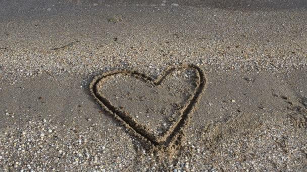Heart on sand. Shooting on the beach.