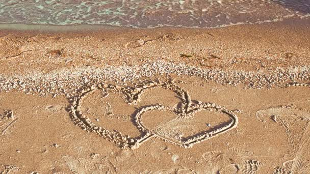 The loving hearts. Two hearts on the beach.