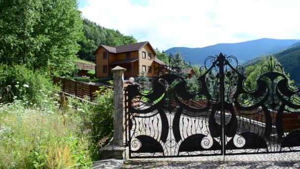 Gate and house. Architecture element