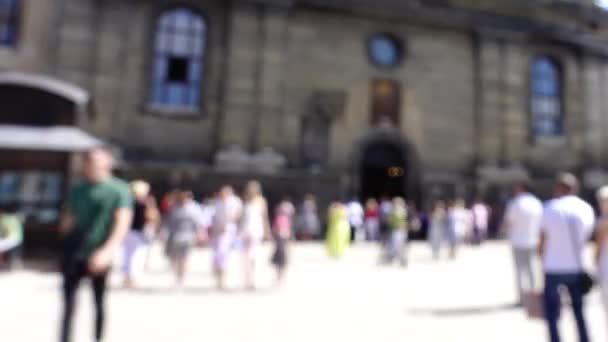 The people near the Catholic Cathedral. Time lapse shoot. Lviv, Ukraine. Out of focus.