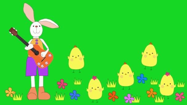 Velikonoční králík hraje na kytaru, kuřata tančí na květinové louce