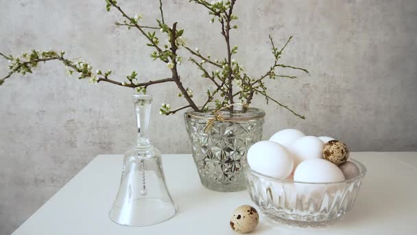 Happy Easter Still life of a spring bouquet, eggs and a glass bell.
