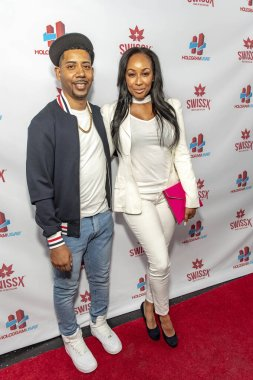 Dre Knight and Tae Knight attend Hologram USA's Debut