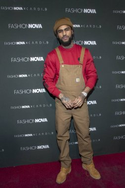Dave East attends Fashion Nova X Cardi B Launch Event, at BOULEVARD 3, Los Angeles, California on November 14th, 2018.