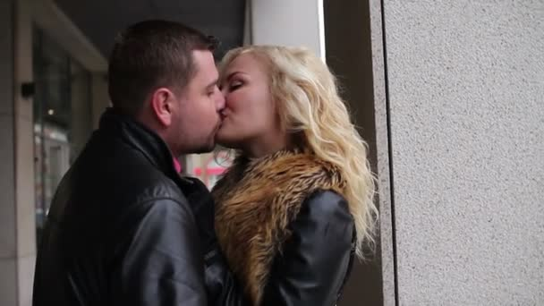 Beautiful couple kissing and laughing