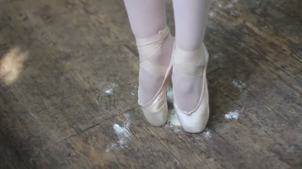Ballet dancer stand on pointe in the ballet hall on rosin