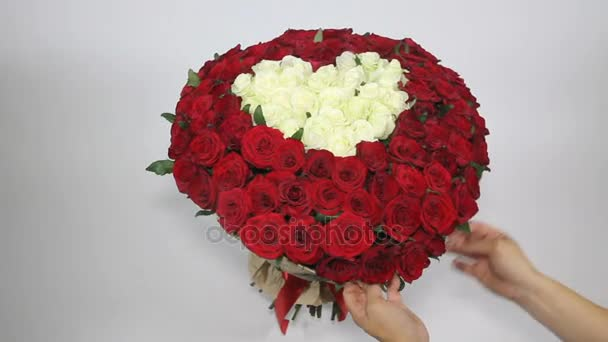 Red roses bouquet with white roses in shape of heart inside