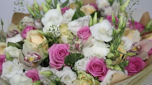 Pink roses and eustoma bouquet with bow