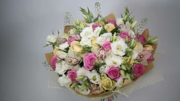 Pink roses and eustoma bouquet with bow. top view. left to right motion.