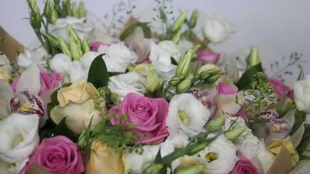 Close up of turning bouquet of pink roses and eustoma