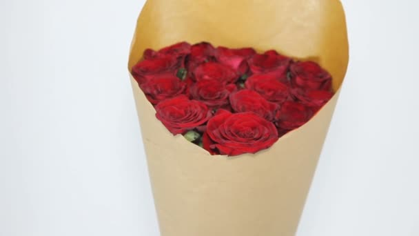 Red roses bouquet in paper package
