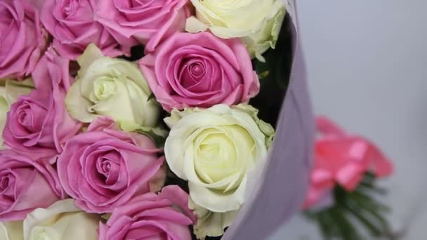 Pink and white roses bouquet. camers at angle