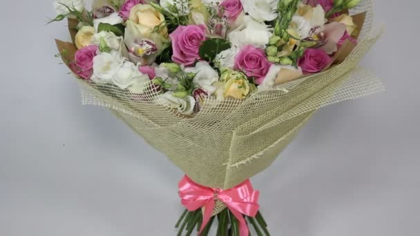 Pink roses and eustoma bouquet with bow. bottom to top motion