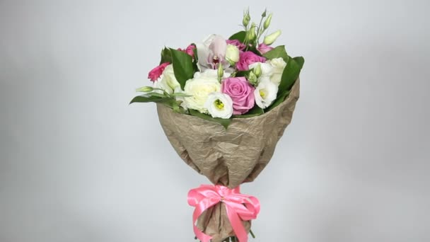 Bouquet of roses, eustoma and orchids turns on white background