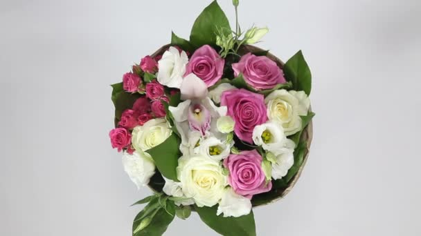Bouquet of roses, eustoma and orchids on white background. top view
