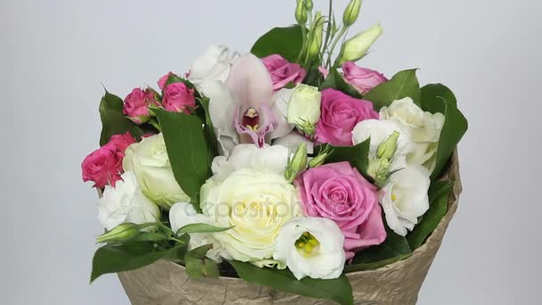 Bouquet of roses, eustoma and orchids on white background close up