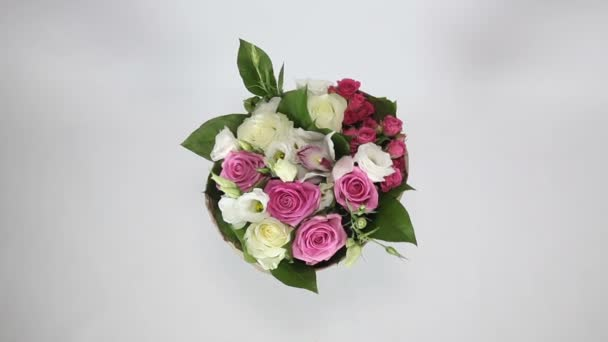 Top view of beautiful tirning bouquet of roses, eustoma and orchids