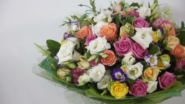 Pink roses and eustoma bouquet with bow. left to right motion.
