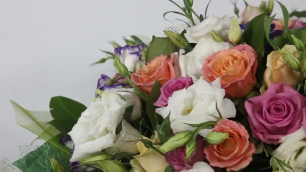 Pink roses and eustoma bouquet with bow . close up