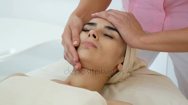 Women on the couch at the beauty parlor on face massage