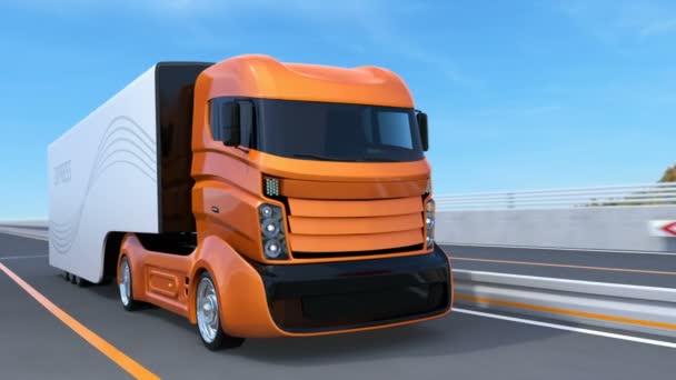 Orange self driving truck on the highway