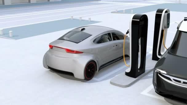 Elektrická dodávka minivan a stříbrný sedan nabíjení nabíjecí stanice. 3D vykreslování animace