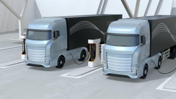 Obecný design modrá Těžké elektrické nákladní automobily nabíjení na veřejné nabíjecí stanici. Nabíjecí stanice je vybavena střešními solárními panely. Animace 3D vykreslování.