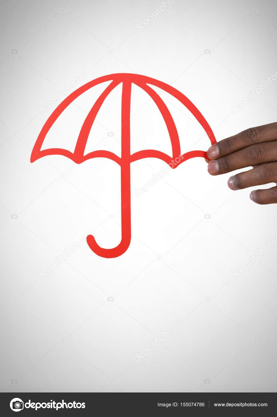 Cut Out Of Umbrella In Hand Stock Photo