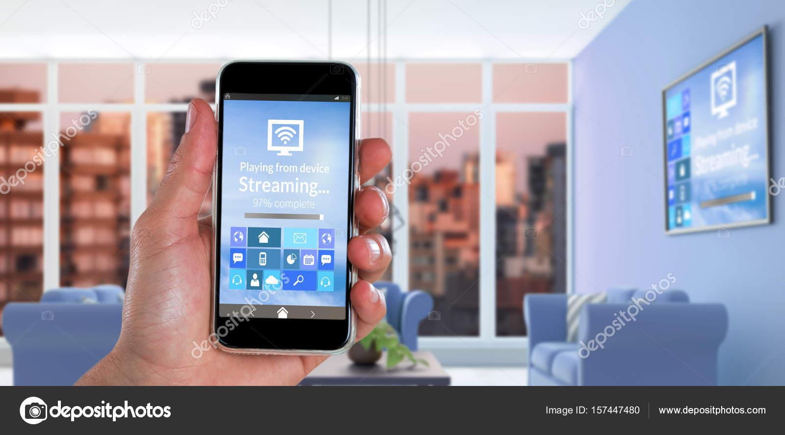 Hand mit Smartphone gegen digital composite innen — Stockfoto ...