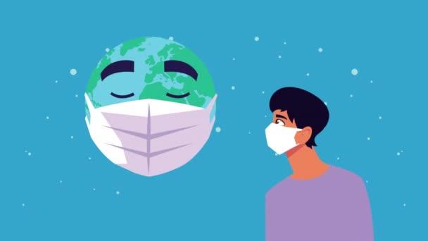 junger Mann und Planet Erde mit Gesichtsmaske für covid19
