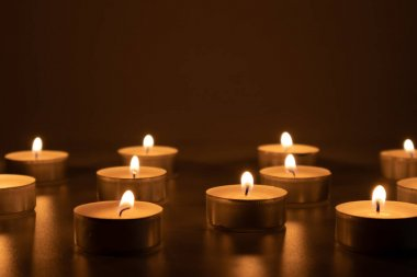 Candles burning in the darkness, devotional and religious image