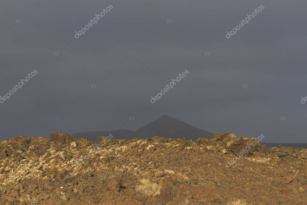 Volcanic rock from lava flow. Lava field in Timanfaya National Park in Lanzarote, Canary Islands, Spain.