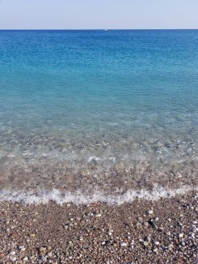 The azure beach of the island of Rhodes. Greece. Mediterranean Sea. Crystal clear water