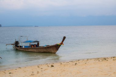 Long tail boat on tropical beach with sky Evening sunlight