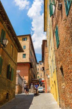 street scene in Siena, Tuscany, Italy