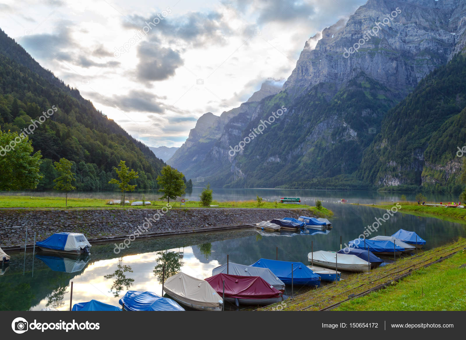 Camping On The Shore Of The Lake Boats On The Dock Switzerlan