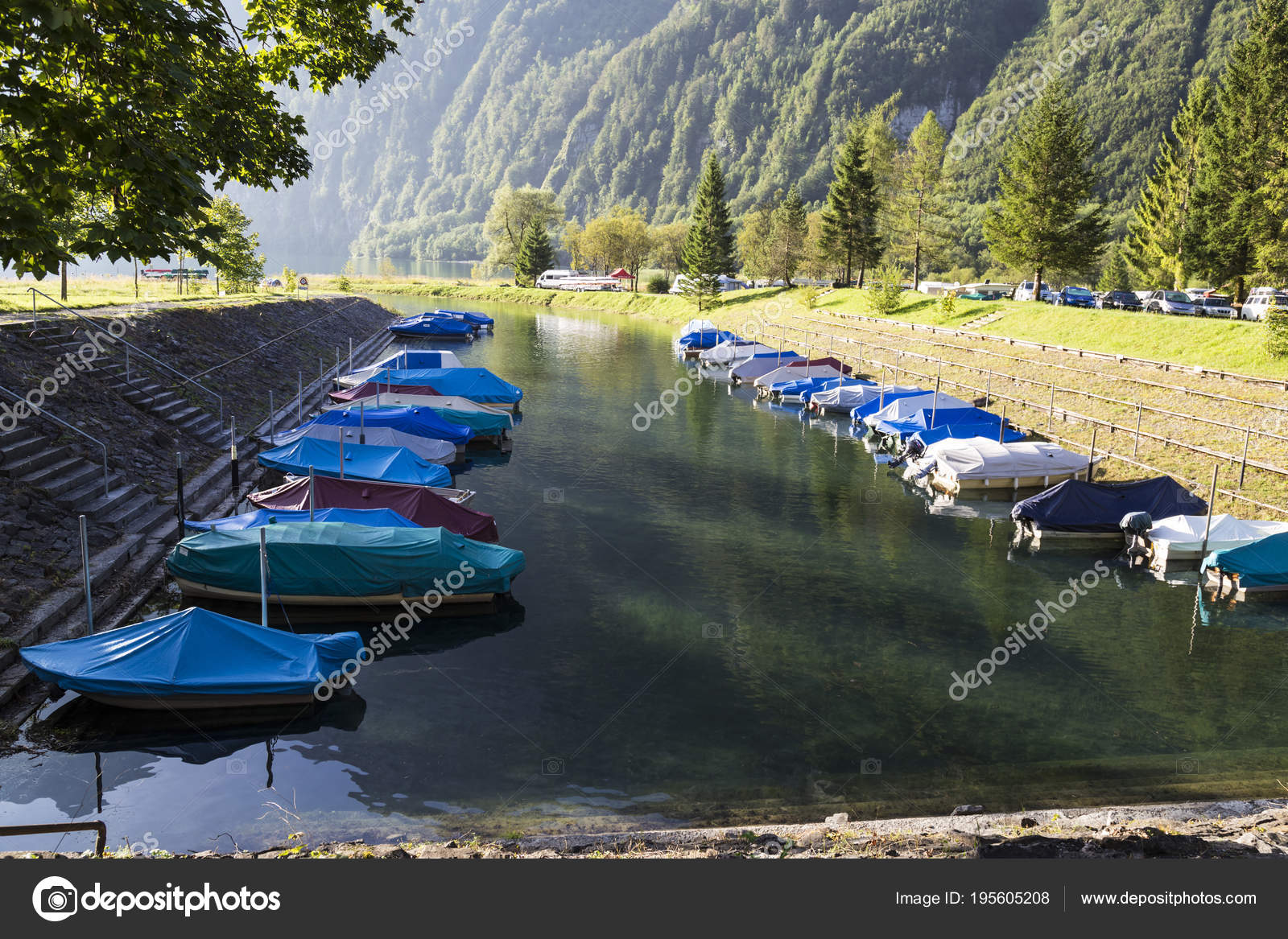 Camping On The Shore Of The Montain Lake Klontalersee Boats On