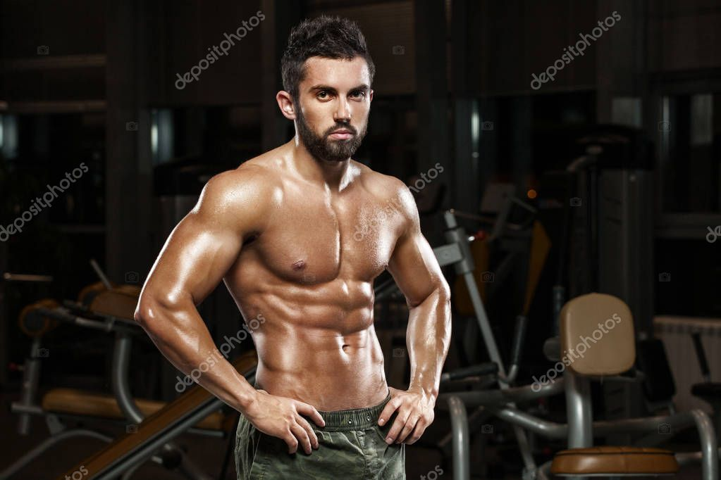 Strong Athletic Man Handsome Male Fitness Model Showing