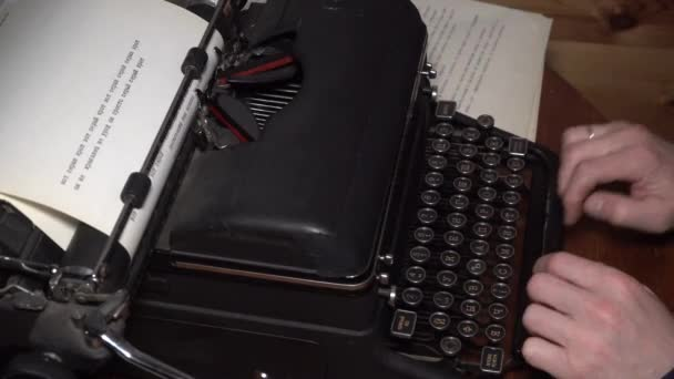 Closeup view of typing text typewriter and carriage return mans hands russian