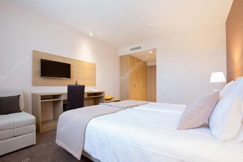 Modern Beautiful Double Bed Hotel Bedroom Interior Stock Photo
