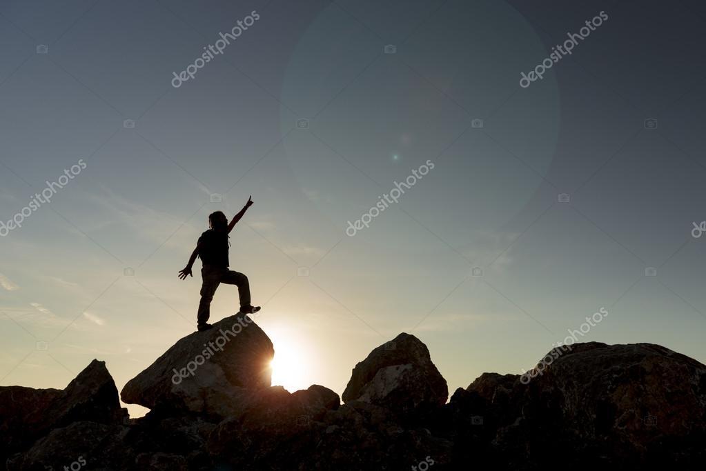 man climbing to the summit & successful climbers